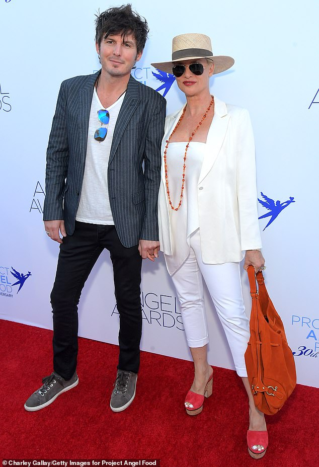 Still going strong!Desperate Housewives star Nicollette Sheridan attended the Project Angel Food Awards in Los Angeles on Saturday. The blonde beauty looked happy with beau Jake Marcus as they held hands