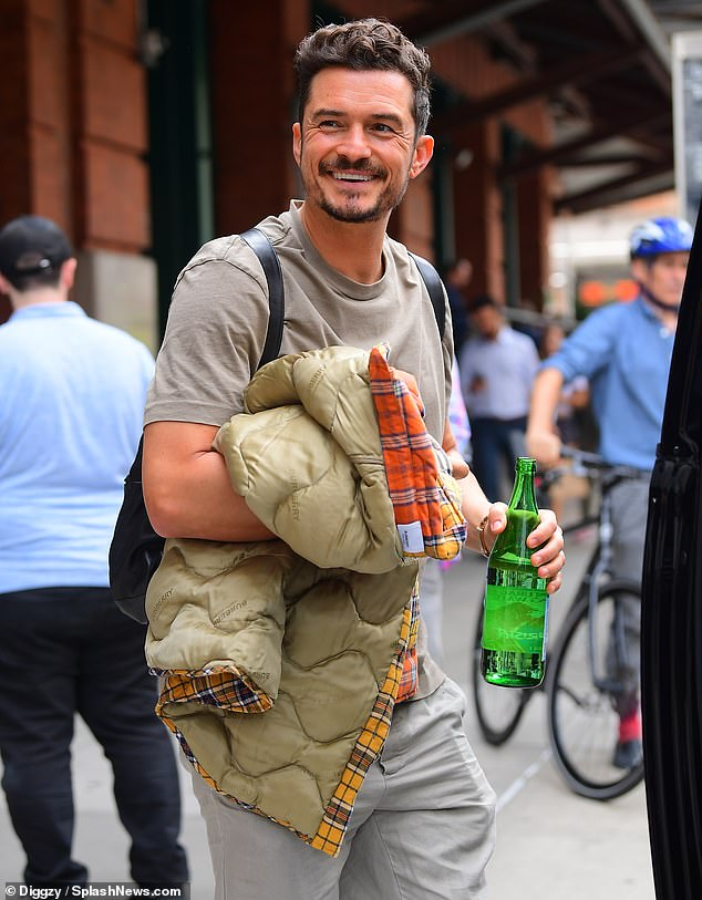 Upbeat: Orlando Bloom was in high spirits as he greeted fans in New York City on Thursday afternoon while promoting Amazon series Carnival Row