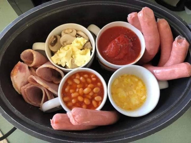A Scottish breakfast of mushroom, tomatoes, beans, sausages and ham