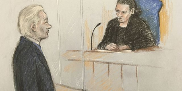 A court artist sketch showing Julian Assange facing District Judge Vanessa Baraitser at Westminster Magistrates' Court in London, on Monday.