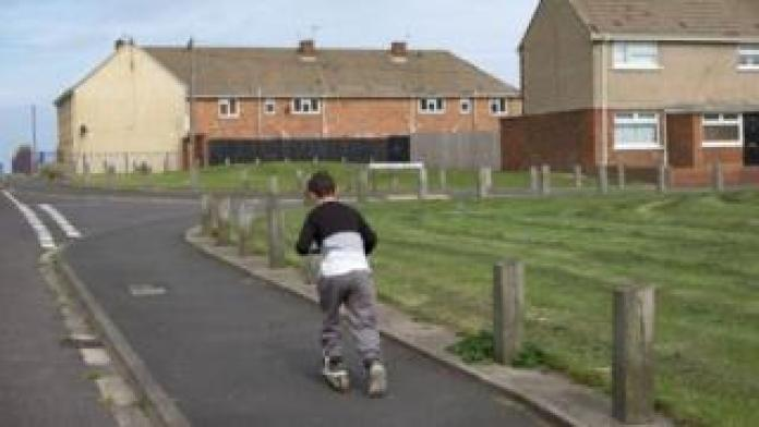 Boy plays on the street in Hartlepool