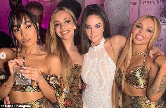Happy days: Pulling her now iconic 'Female Boss' pose, Tulisa posed alongside Jesy Nelson, 28, Jade Thirlwall, 26, and Leigh-Anne Pinnock, 28, with only Perrie Edwards, 26, absent, as the Playing With Fire singer revealed she had gone home early