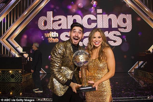 Prized trophy: Hannah and Alan beamed while holding the Mirrorball Trophy after winning season 28 of DWTS