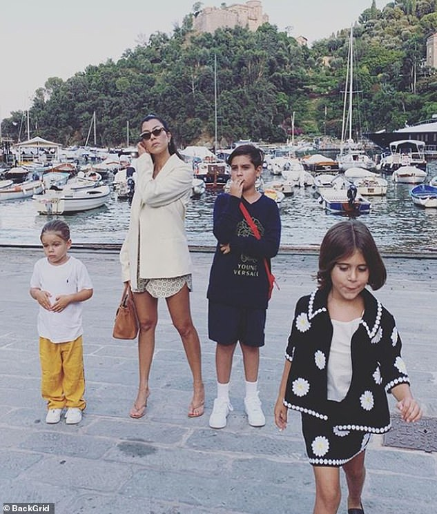 Mom-of-three: Kourtney shares sons Mason, nine, and Reign, four, and daughter Penelope, seven, with former partner Scott Disick. The pair split in 2015