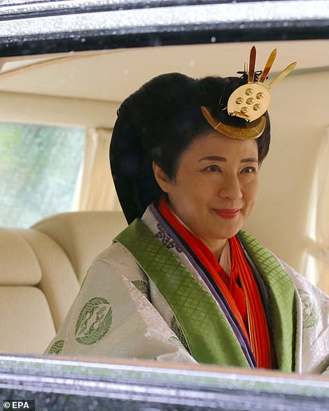 Empress Masako arrived separately to the emperor in a vehicle due to her allergy to horses