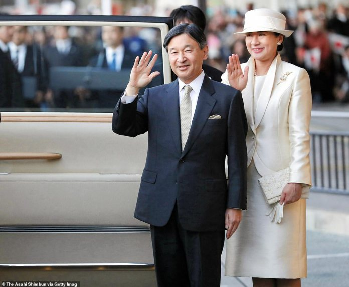 Emperor Naruhito and Empress Masako wave to well-wishers on arrival at the Uji Yamada Station on their way to the Ise Shrine on November 21, 2019 in Ise, Mie, Japan