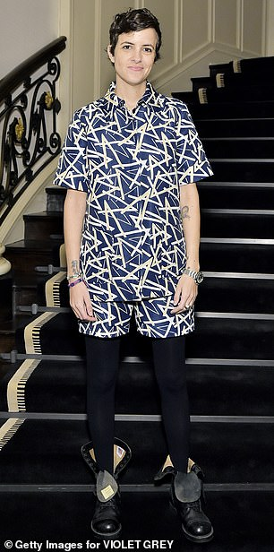 Printed set: Samantha Ronson sported a blue shirt and shorts set with a beige line print, over navy blue stockings with black combat boots