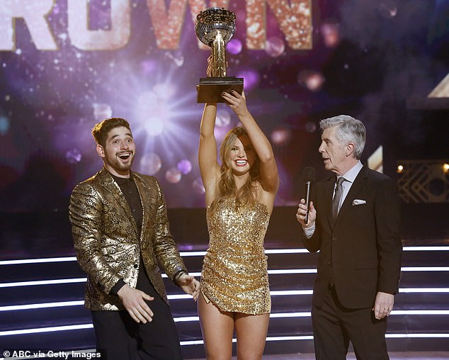 Mirrored trophy: The Bachelorett star held up her Mirrorball Trophy after winning