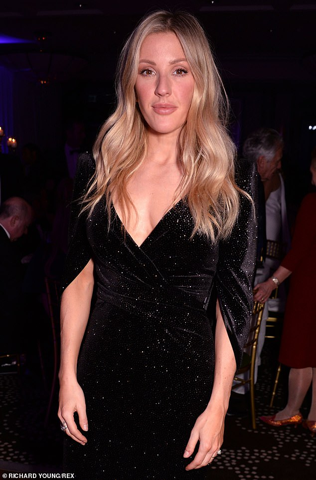 Vixen:Singer Ellie was also sparkled in a beautiful black velvet dress with capped sleeves and sequinned effect
