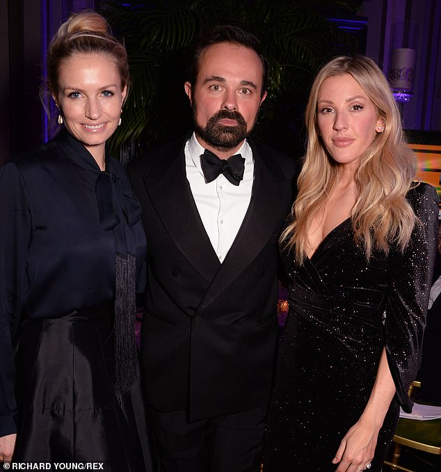 Happy: Ellie also posed with singer James Blunt's wife Sofia [L] and Russian mogulEvgeny Lebedev