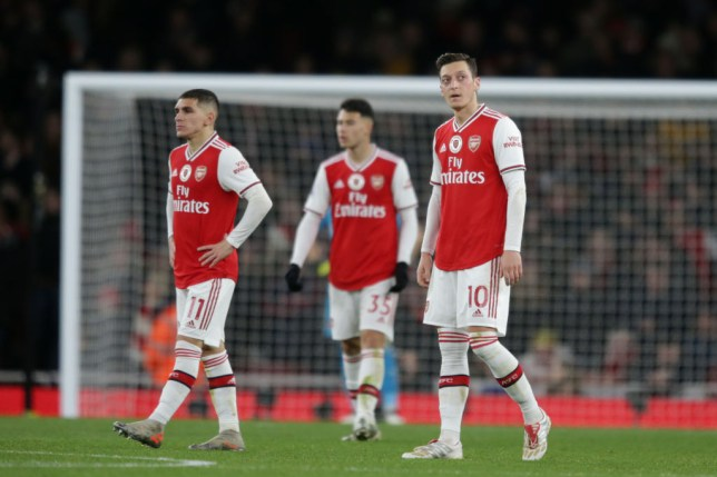 Mesut Ozil and Arsenal players look downtrodden after defeat to Manchester City