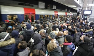 Commuters wait on a platform at the Gare du Nord RER station in Paris