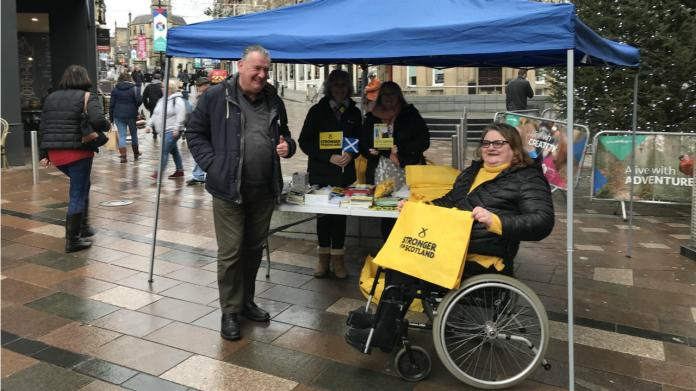 SNP activists including Scott Farmer, far-left, and Morag Fulton, far-right, in central Stirling.