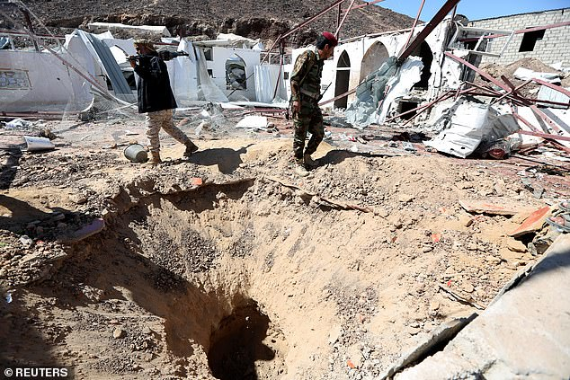 Saudi-backed Yemeni troops inspect the site where a Houthi missile struck a barracks mosque on Saturday night during evening prayers. Today officials announced the death toll had risen to 116
