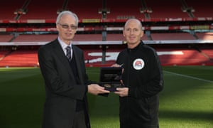 Referee Mike Dean (right) is presented with his Premier League 500 matches award prior to the game between Arsenal and Sheffield United.