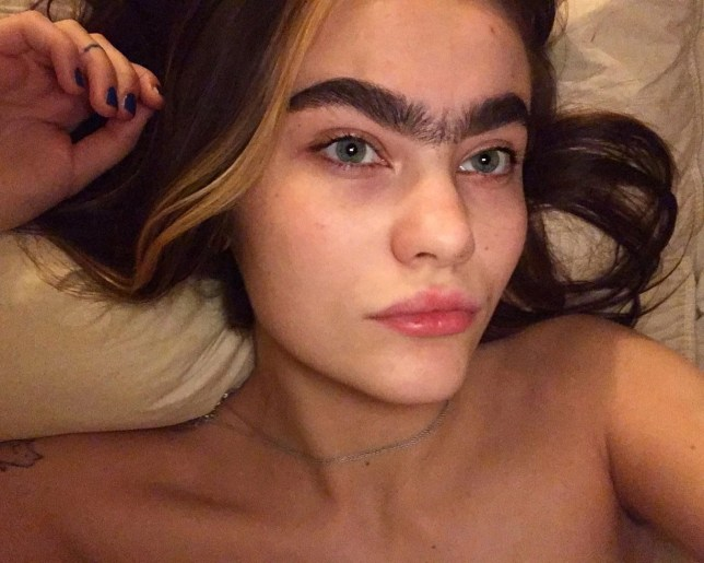 Sarah pictured lying down showing off her unibrow