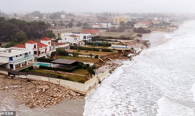 Several houses along a stretch of the coast had walls demolished and gardens washed away during the vicious storm