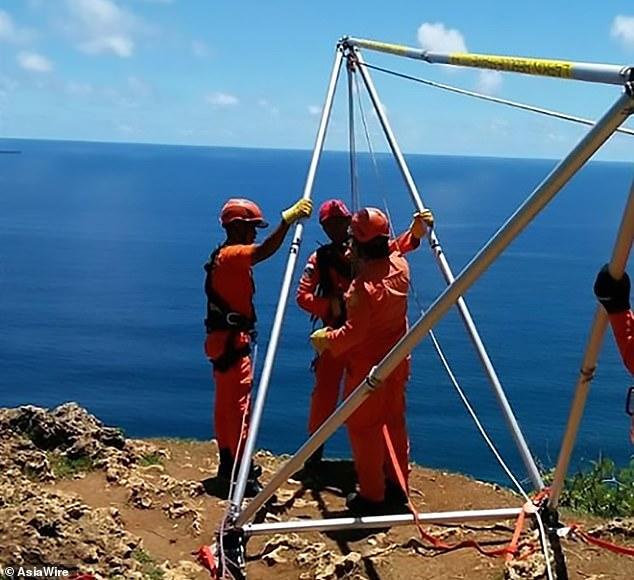 The bottom of the cliffs, which rise over 500ft above the sea, are covered in bushes and difficult to reach, rescue teams in Bali said