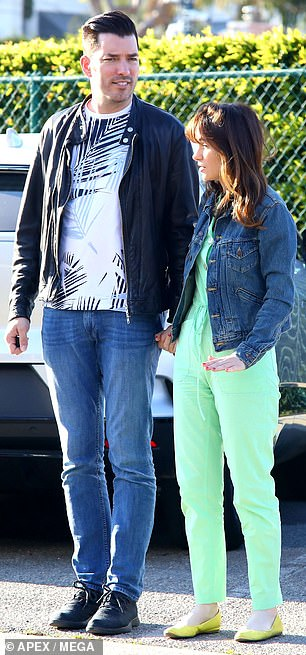 Her look: The blue-eyed beauty wore a bright green jumpsuit paired with coordinating flats. Zooey kept warm beneath a denim jacket