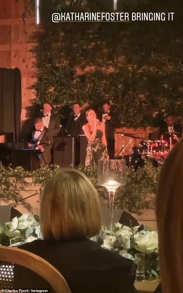 Bringing it: Erin's father David Foster performed Proud Mary with his wife Katharine McPhee (pictured with the band) during the reception as a special gift to the couple