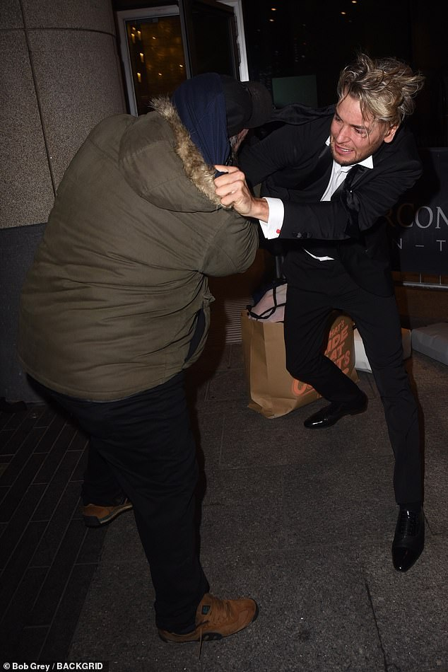 The celebrations looked to be short-lived, as Chris found himself grappling with a photographer outside the O2 in the early hours of Wednesday morning