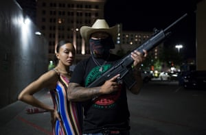 Young New Mexicans Celebrating Cinco de Mayo, 2019, Downtown Albuquerque. Two teenagers explain to me they must arm themselves amidst a rising homicide rate in the city.