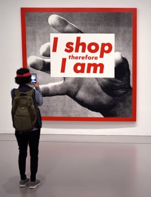 A photographic silkscreen print by Kruger titled I Shop Therefore I Am at the Hirshhorn Museum and Sculpture Garden on the National Mall in Washington DC.