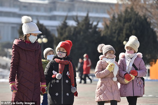 North Korea has becomes the twenty-ninth country to record a case of the killer coronavirus, local media report. Pictured, children in masks in Pyongyang