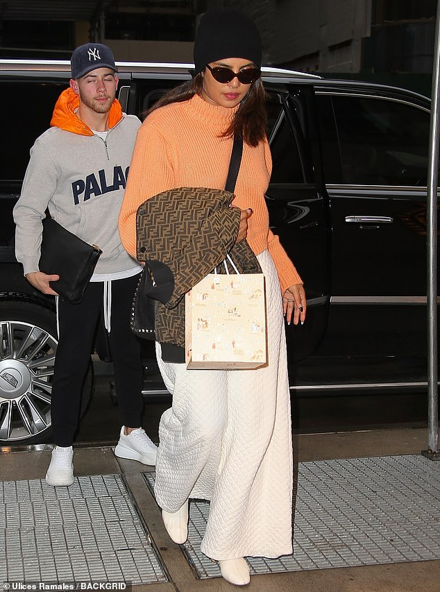 Home sweet home: Priyanka Chopra, 37, looked cozy and relaxed as she finally arrived to her apartment in NYC with her husband Nick Jonas, 27, after traveling from Mumbai, India