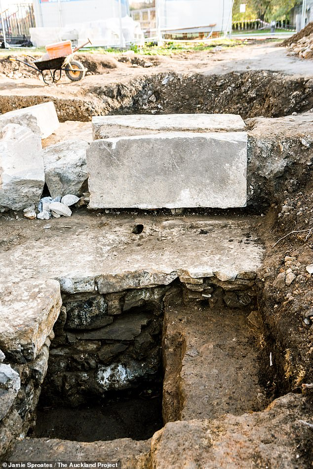 Pictured, researchers found the base stone for a buttress cracked in two — damage possibly caused during the demolition of the chapel Beneath the stone, what is thought to be a charge hole for gunpowder can be seen