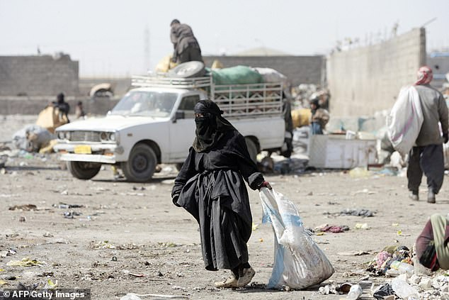An Iraqi woman is pictured collecting plastic and metal bottles from a garbage dump in Baghdad in 2008. In 2008, reports said that Iraqi women felt they were worse off than they were under the regime of Saddam Hussein and that their plight deteriorated year by year since the US-led invasion