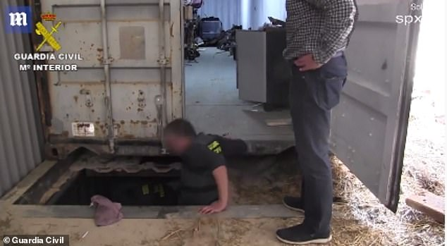 Spanish Police pictured entering the bunker after moving the shipping container to the side