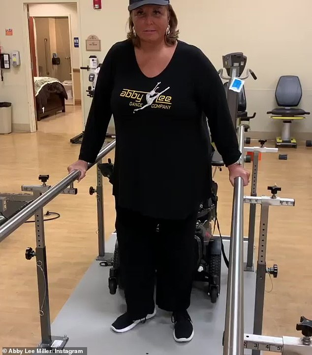 Making the effort: Miller's Instagram is filled with snippets showing her ongoing journey with learning to walk again during physical therapy sessions