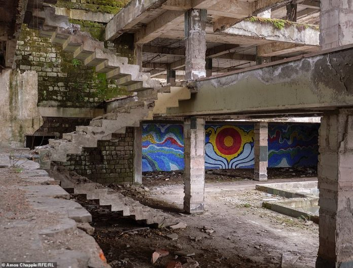 In its glory days, this was a beautiful sanatorium swimming pool. Now, it's an eerie ruin