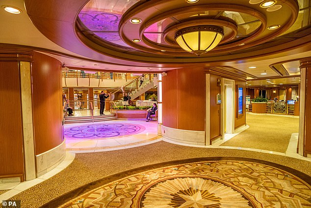 Another picture shows the almost deserted inside of the Diamond Princess where passengers are confined to their cabins