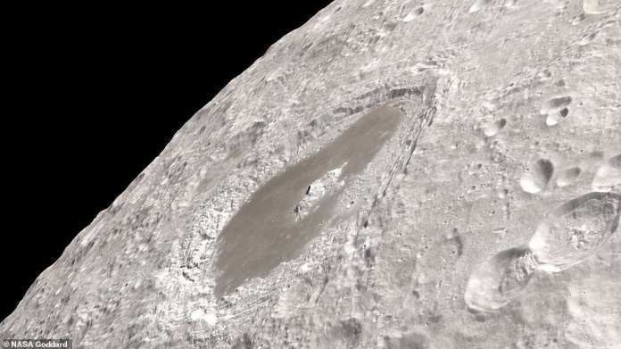The two-minute clip opens in darkness to honor the crew that were in pitch black for eight minutes while sitting between earthset and sunrise. The sun then appears from around the corner, revealing the lunar surface's majestic craters and pot marks