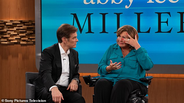 Talking with the host: Dr Oz leaned in while his guest was wiping away her tears