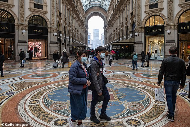Two people wearing masks walk through theGalleria Vittorio Emanuele II in Milan yesterday, in northern Italy which is at the centre of the outbreak