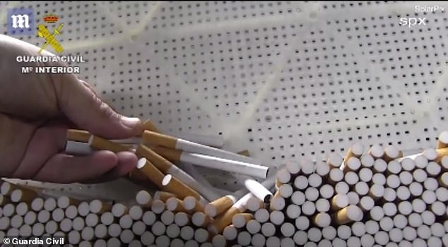 Cigarettes piled up after they were created by the machine in the underground bunker