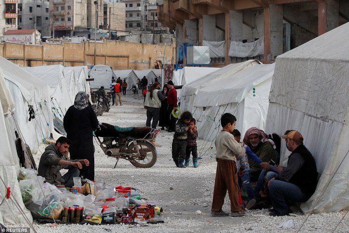 Internally displaced Syrians are seen in an IDP camp located in Idlib earlier today