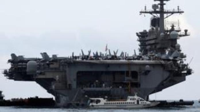 The USS Theodore Roosevelt enters port in Vietnam
