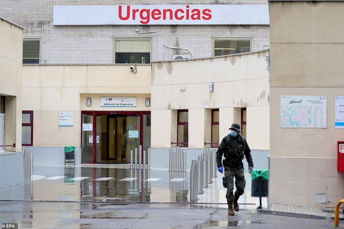 A soldier works in setting up a field hospital on the outside of Gregorio Maranon Hospital in Madrid, where the largest number of new cases and deaths have been reported