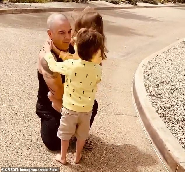 Keeping away:Ayda has remained at home in Los Angeles with her and Robbie's children, Theodora, Charlton, Colette, 18 months, and newborn Beau