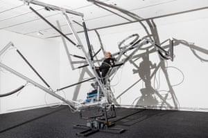 Australian performance artist Stelarc in his sculpture, Reclining Stickman