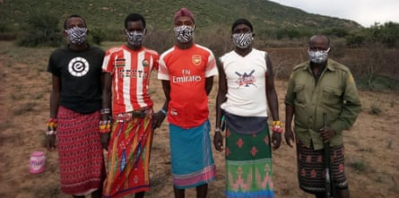 Cattle herders wearing masks provided by Grevy's Zebra Trust.