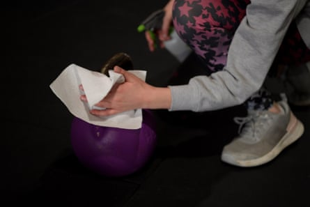 Gym goers wipe down equipment as they work out in Adelaide.