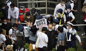 People protest against police violence in Tokyo.