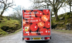Tesco supermarket van rear delivering food to a customer home in rural Wales during the Covid-19 pandemic