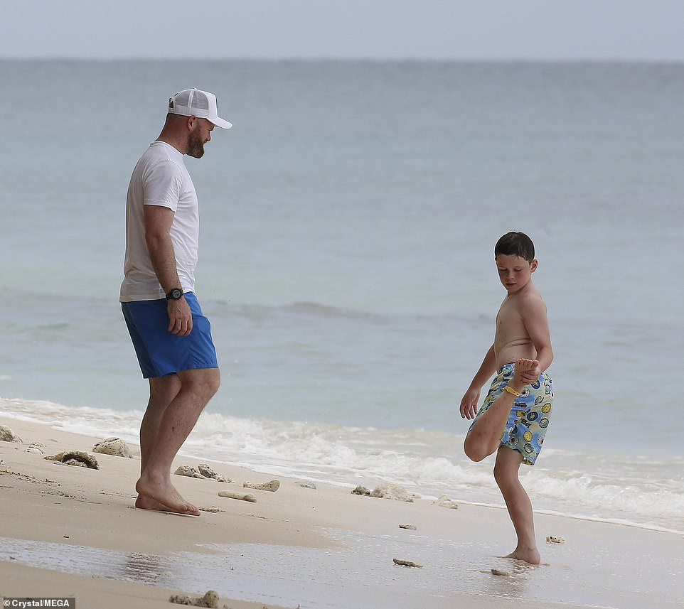 Bonding time: Former Manchester United ace Wayne enjoyed some bonding time with his sons as they basked in the sunshine