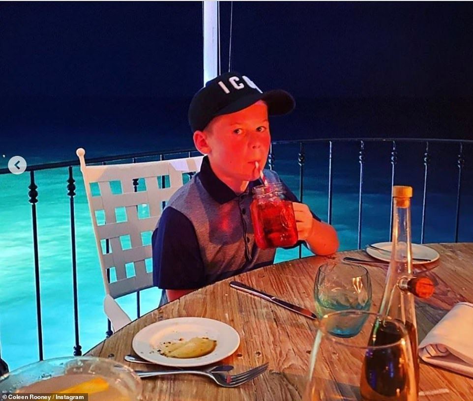 Looking cool: Kai donned a baseball cap for their evening meal and sipped on a refreshing drink